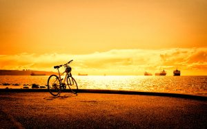 Bicycle-Parked-At-Sunset-Hd-Image