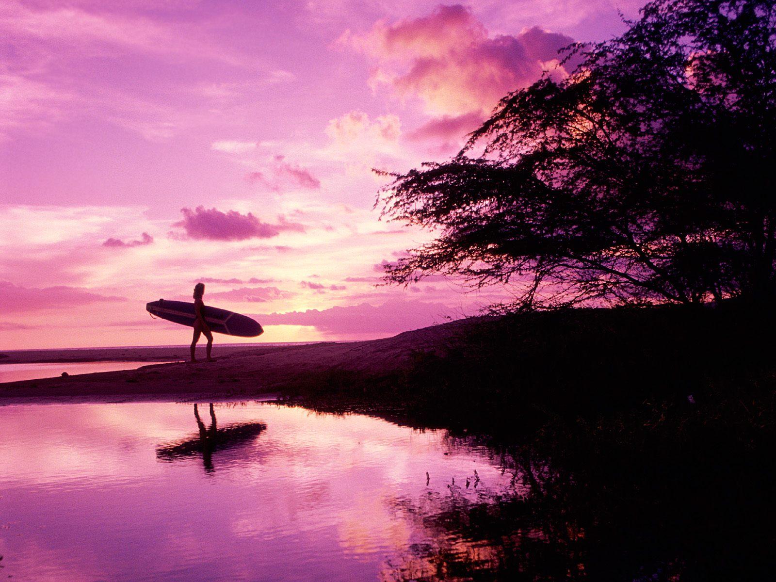 Серфингисты на закате загрузить